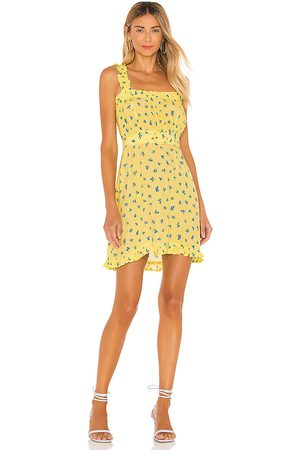 FAITHFULL THE BRAND Mid Summer Mini Dress in Yellow.