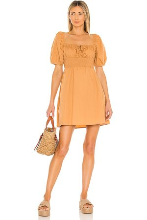 FAITHFULL THE BRAND Mariette Mini Dress in Tan.