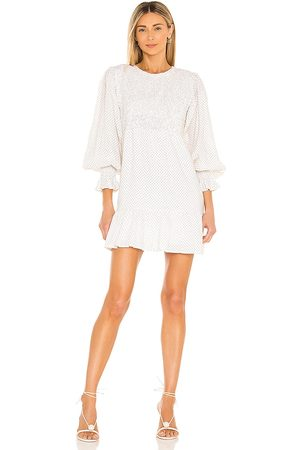 FAITHFULL THE BRAND Rosie Mini Dress in White.